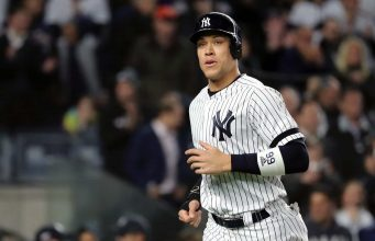 NEW YORK, NEW YORK - OCTOBER 17: Aaron Judge #99 of the New York Yankees comes home to score a run on a walk against the Houston Astros during the first inningin game four of the American League Championship Series at Yankee Stadium on October 17, 2019 in New York City.