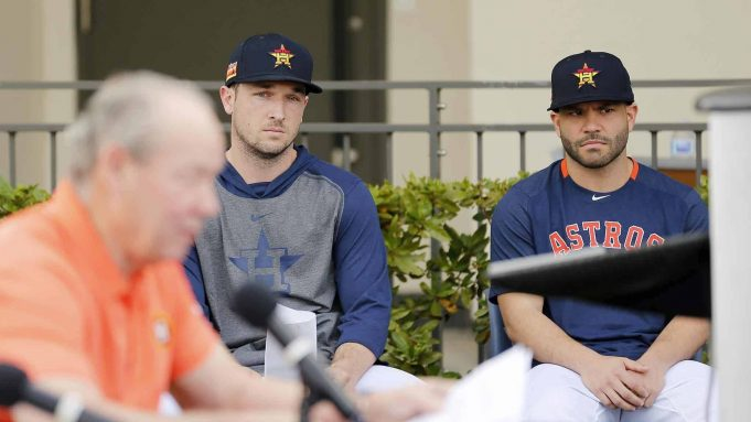 WEST PALM BEACH, FLORIDA - FEBRUARY 13: Alex Bregman #2 and Jose Altuve #27 of the Houston Astros look on as owner Jim Crane reads a prepared statement during a press conference at FITTEAM Ballpark of The Palm Beaches on February 13, 2020 in West Palm Beach, Florida.