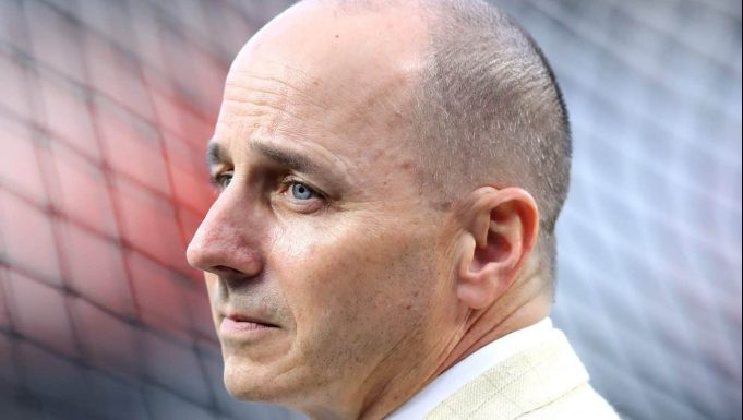 NEW YORK, NEW YORK - OCTOBER 03: : General Manager of the New York Yankees Brian Cashman looks on prior to the American League Wild Card Game between the Oakland Athletics and the New York Yankees at Yankee Stadium on October 03, 2018 in the Bronx borough of New York City.