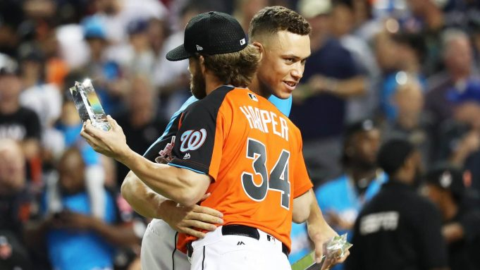 MIAMI, FL - JULY 10: Aaron Judge #99 of the New York Yankees hugs Bryce Harper #34 of the Washington Nationals and the National League in the T-Mobile Home Run Derby at Marlins Park on July 10, 2017 in Miami, Florida.