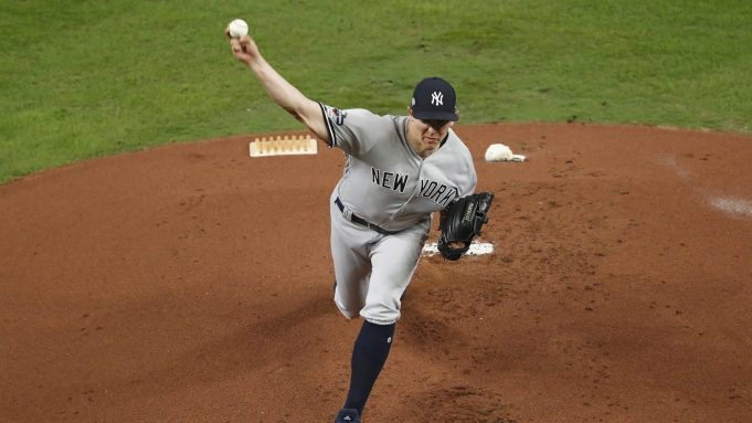 HOUSTON, TX - OCTOBER 19: Chad Green #57 of the New York Yankees pitches in the first inning against the Houston Astros during Game Six of the League Championship Series at Minute Maid Park on October 19, 2019 in Houston, Texas.