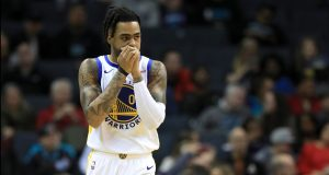 CHARLOTTE, NORTH CAROLINA - DECEMBER 04: D'Angelo Russell #0 of the Golden State Warriors watches on against the Charlotte Hornets during their game at Spectrum Center on December 04, 2019 in Charlotte, North Carolina. NOTE TO USER: User expressly acknowledges and agrees that, by downloading and or using this photograph, User is consenting to the terms and conditions of the Getty Images License Agreement.