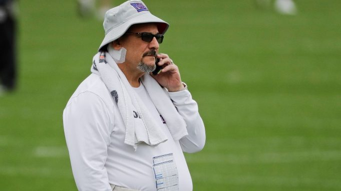 New York Giants general manager Dave Gettleman watches as his team runs drills at the NFL football team's training facility Wednesday, June 5, 2019, in East Rutherford, N.J.