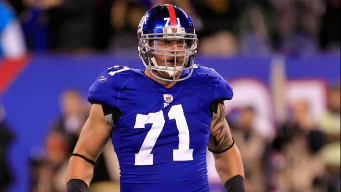 EAST RUTHERFORD, NJ - DECEMBER 04: Dave Tollefson #71 of the New York Giants reacts after he recorded a sack against the Green Bay Packers at MetLife Stadium on December 4, 2011 in East Rutherford, New Jersey.