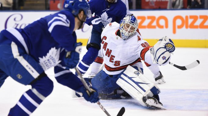 Toronto Maple Leafs left wing Pierre Engvall (47) scores his team's third goal of the game against Carolina Hurricanes emergency goalie David Ayres (90) during second-period NHL hockey game action in Toronto, Saturday, Feb. 22, 2020.