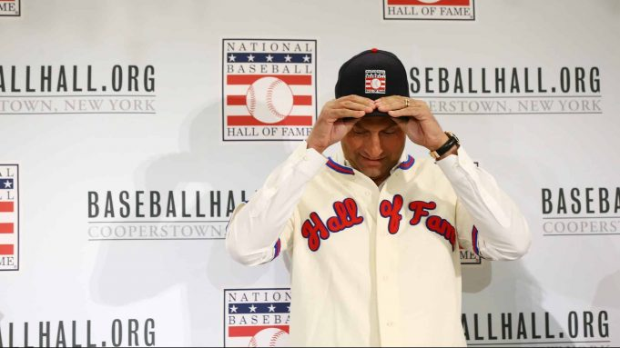 NEW YORK, NEW YORK - JANUARY 22: Derek Jeter puts on his Hall of Fame hat after being elected into the National Baseball Hall of Fame Class of 2020 on January 22, 2020 at the St. Regis Hotel in New York City. The National Baseball Hall of Fame induction ceremony will be held on Sunday, July 26, 2020 in Cooperstown, NY.