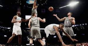 NEW YORK, NEW YORK - DECEMBER 11: Spencer Dinwiddie #8 of the Brooklyn Nets catches the rebound as Michael Kidd-Gilchrist #14 of the Charlotte Hornets falls on the court during the second half at Barclays Center on December 11, 2019 in New York City.