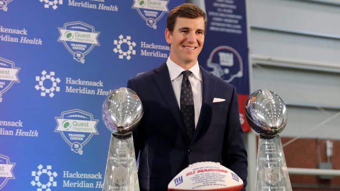 EAST RUTHERFORD, NEW JERSEY - JANUARY 24: Eli Manning of the New York Giants poses with the Vince Lombardi Trophies after a press conference to announce his retirement on January 24, 2020 at Quest Diagnostic Training Center in East Rutherford, New Jersey.The two time Super Bowl MVP is retiring after 16 seasons with the team.