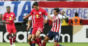 ZAPOPAN, MEXICO - APRIL 04: Jose Macias of Chivas fights for the ball with Florian Valot of New York RB during the semifinal match between Chivas and New York RB as part of the CONCACAF Champions League at Akron Stadium on April 4, 2018 in Zapopan, Mexico.