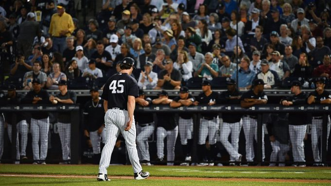 TAMPA, FLORIDA - FEBRUARY 24: Gerrit Cole #45 of the New York Yankees heads to the dugout after pitching in the first inning during the spring training game against the Pittsburgh Pirates at Steinbrenner Field on February 24, 2020 in Tampa, Florida.