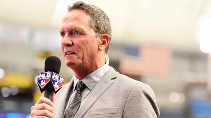 ST PETERSBURG, FL - SEPTEMBER 27: David Cone formally of the New York Yankees gets interviewed during pregame before the Tampa Bay Rays play against the New York Yankees on September 27, 2018 at Tropicana Field in St Petersburg, Florida.