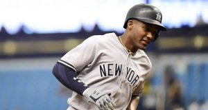 ST PETERSBURG, FL - SEPTEMBER 27: Miguel Andujar #41 of the New York Yankees hits a three-run homer in the first inning against the Tampa Bay Rays on September 27, 2018 at Tropicana Field in St Petersburg, Florida.