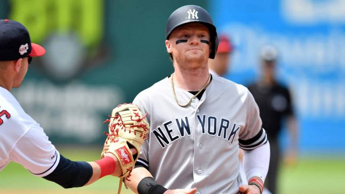 CLEVELAND, OHIO - JUNE 09: First baseman Jake Bauers #10 of the Cleveland Indians catches Clint Frazier #77 of the New York Yankees in a run down during the third inning at Progressive Field on June 09, 2019 in Cleveland, Ohio.