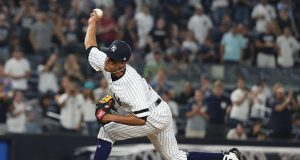 NEW YORK, NEW YORK - AUGUST 11: Adonis Rosa #73 of the New York Yankees makes his Major League debut pitching against the Baltimore Orioles during their game at Yankee Stadium on August 11, 2019 in New York City.