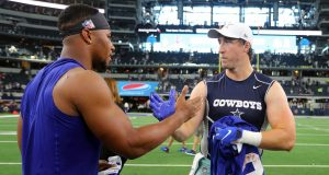 ARLINGTON, TEXAS - SEPTEMBER 08: Saquon Barkley #26 of the New York Giants and Sean Lee #50 of the Dallas Cowboys shakes hands after trading jerseys after the game at AT&T Stadium on September 08, 2019 in Arlington, Texas.