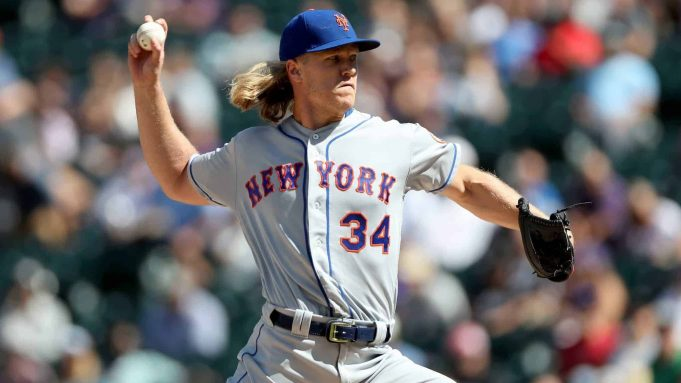 DENVER, COLORADO - SEPTEMBER 18: Starting pitcher Noah Syndergaard #34 of the New York Mets throws in the first inning against the Colorado Rockies at Coors Field on September 18, 2019 in Denver, Colorado.