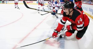 NEWARK, NEW JERSEY - SEPTEMBER 20: Steven Fogarty #29 of the New York Rangers checks Joey Anderson #14 of the New Jersey Devils in the corner during the second period at the Prudential Center on September 20, 2019 in Newark, New Jersey.