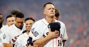 HOUSTON, TEXAS - OCTOBER 22: AJ Hinch #14 of the Houston Astros stands for the national anthem prior to Game One of the 2019 World Series against the Washington Nationals at Minute Maid Park on October 22, 2019 in Houston, Texas.