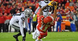KANSAS CITY, MO - DECEMBER 01: Wide receiver Demarcus Robinson #11 of the Kansas City Chiefs stretches for extra yardage against cornerback Trayvon Mullen #27 of the Oakland Raiders during the second half at Arrowhead Stadium on December 1, 2019 in Kansas City, Missouri.