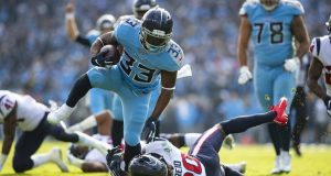 NASHVILLE, TN - DECEMBER 15: Justin Reid #20 of the Houston Texans trips up Dion Lewis #33 of the Tennessee Titans as he carries the ball in the red zone during the second quarter at Nissan Stadium on December 15, 2019 in Nashville, Tennessee.