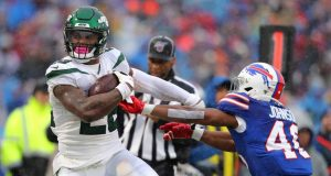 ORCHARD PARK, NY - DECEMBER 29: Jaquan Johnson #46 of the Buffalo Bills tries to make a tackle on Le'Veon Bell #26 of the New York Jets as he runs the ball during the first half at New Era Field on December 29, 2019 in Orchard Park, New York.