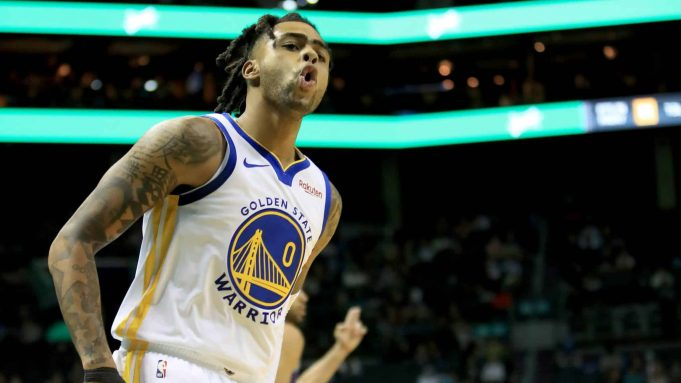 CHARLOTTE, NORTH CAROLINA - DECEMBER 04: D'Angelo Russell #0 of the Golden State Warriors reacts after making a basket against the Charlotte Hornets during their game at Spectrum Center on December 04, 2019 in Charlotte, North Carolina. NOTE TO USER: User expressly acknowledges and agrees that, by downloading and or using this photograph, User is consenting to the terms and conditions of the Getty Images License Agreement. (Photo by Streeter Lecka/Getty Images)