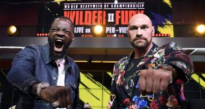LOS ANGELES, CA - JANUARY 25: Deontay Wilder (L) and Tyson Fury face off during a news conference at Fox Studios on January 25, 2020 in Los Angeles, California.