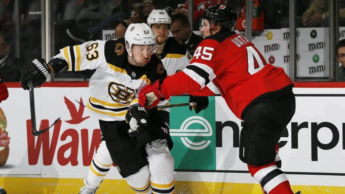 NEWARK, NJ - DECEMBER 31: Brad Marchand #63 of the Boston Bruins tries to skate past Sami Vatanen #45 of the New Jersey Devils during an NHL hockey game on December 31, 2019 at the Prudential Center in Newark, New Jersey. Devils won 3-2 in a shootout.
