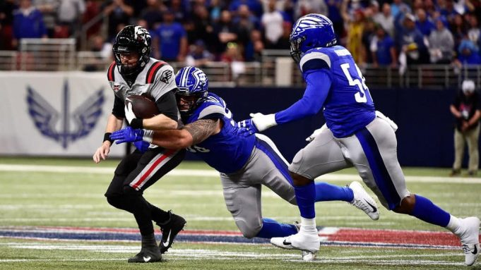 ST LOUIS, MO - FEBRUARY 23: Matt McGloin #14 of the NY Guardians is sacked by Casey Sayles #90 of the St. Louis Battlehawks during the first half of an XFL game at The Dome at America Center on February 23, 2020 in St Louis, Missouri.