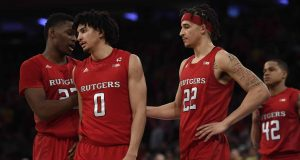 NEW YORK, NEW YORK - FEBRUARY 01: Geo Baker #0 and Caleb McConnell #22 of the Rutgers Scarlet Knights react during the second half against the Michigan Wolverines at Madison Square Garden on February 01, 2020 in New York City. The Michigan Wolverines won 69-63.