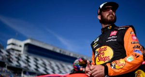 DAYTONA BEACH, FLORIDA - FEBRUARY 09: Martin Truex Jr., driver of the #19 Bass Pros Shops Toyota, stands on the grid during qualifying for the NASCAR Cup Series 62nd Annual Daytona 500 at Daytona International Speedway on February 09, 2020 in Daytona Beach, Florida.