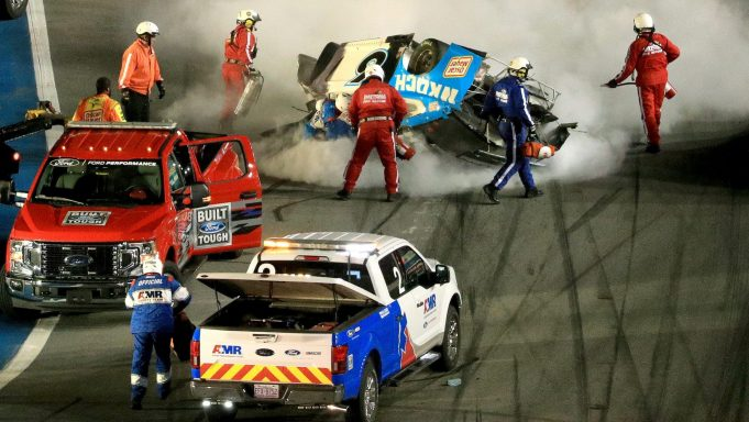DAYTONA BEACH, FLORIDA - FEBRUARY 17: Track workers attend to Ryan Newman, driver of the #6 Koch Industries Ford, following a crash during the NASCAR Cup Series 62nd Annual Daytona 500 at Daytona International Speedway on February 17, 2020 in Daytona Beach, Florida.