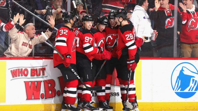 NEWARK, NEW JERSEY - FEBRUARY 20: Jesper Bratt #63 of the New Jersey Devils (C) celebrates his goal against Martin Jones #31 of the San Jose Sharks at 16:15 of the second period at the Prudential Center on February 20, 2020 in Newark, New Jersey.
