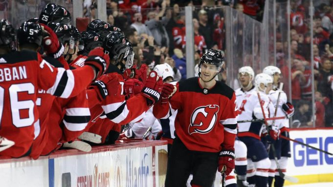 NEWARK, NEW JERSEY - FEBRUARY 22: Damon Severson #28 of the New Jersey Devils celebrates his game winning goal at 18:01 of the third period against the Washington Capitals at the Prudential Center on February 22, 2020 in Newark, New Jersey. The Devils defeated the Capitals 3-2.