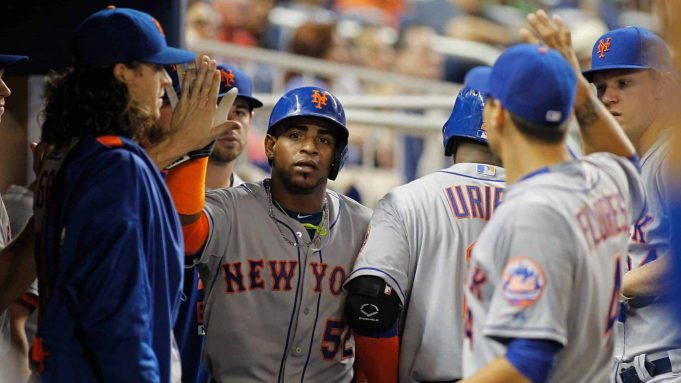 MIAMI, FL - SEPTEMBER 04: Yoenis Cespedes #52 of the New York Mets is congratulated by teammates including pitcher Jacob deGrom (L) after he scored in the sixth inning of play against the Miami Marlins at Marlins Park on September 4, 2015 in Miami, Florida.