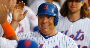 NEW YORK, NY - JUNE 16: Bartolo Colon #40 of the New York Mets celebrates in the dugout after scoring a third-inning run against the Pittsburgh Pirates at Citi Field on June 16, 2016 in the Flushing neighborhood of the Queens borough of New York City.