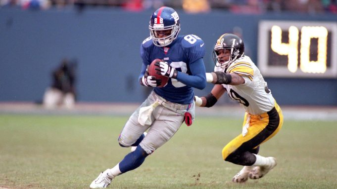 10 Dec 2000: Ike Hilliard #88 of the New York Giants runs with the ball against Chad Scott #30 of the Pittsburgh Steelers during the game at the Giants Stadium in East Rutherford, New Jersey. The Giants defeated the Steelers 30-10.