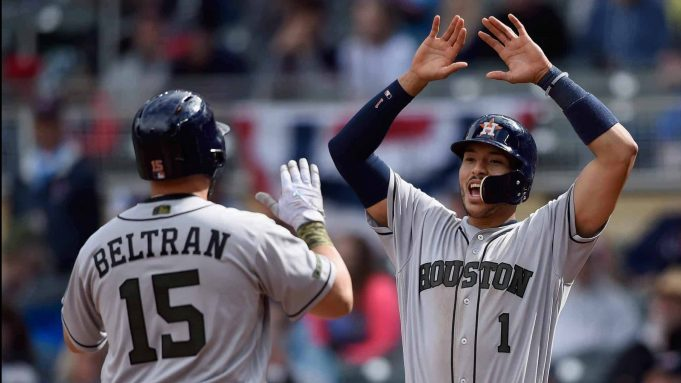 MINNEAPOLIS, MN - MAY 29: Carlos Correa #1 of the Houston Astros congratulates teammate Carlos Beltran #15 on a three-run home run against the Minnesota Twins during the eighth inning of the game on May 29, 2017 at Target Field in Minneapolis, Minnesota. The Astros defeated the Twins 16-8.