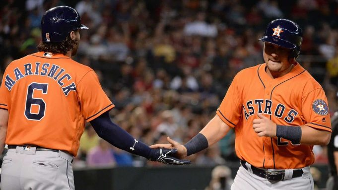 PHOENIX, AZ - AUGUST 15: J.D. Davis #28 of the Houston Astros is congratulated by Jake Marisnick #6 after scoring against the Arizona Diamondbacks in the second inning at Chase Field on August 15, 2017 in Phoenix, Arizona.