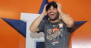 HOUSTON, TX - OCTOBER 21: Jose Altuve #27 of the Houston Astros celebrates in the locker room after defeating the New York Yankees by a score of 4-0 to win Game Seven of the American League Championship Series at Minute Maid Park on October 21, 2017 in Houston, Texas. The Houston Astros advance to face the Los Angeles Dodgers in the World Series.
