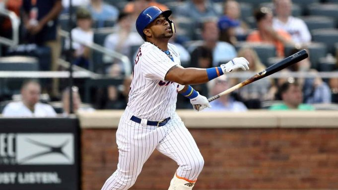 NEW YORK, NY - MAY 02: Yoenis Cespedes #52 of the New York Mets hits a double in the first inning against the Atlanta Braves on May 2, 2018 at Citi Field in the Flushing neighborhood of the Queens borough of New York City.