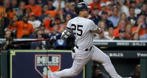 HOUSTON, TEXAS - OCTOBER 19: Gleyber Torres #25 of the New York Yankees hits a single against the Houston Astros during the third inning in game six of the American League Championship Series at Minute Maid Park on October 19, 2019 in Houston, Texas.