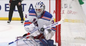 LOS ANGELES, CALIFORNIA - DECEMBER 10: Henrik Lundqvist #30 of the New York Rangers sticks aside a 2po shot against the Los Angeles Kings at the Staples Center on December 10, 2019 in Los Angeles, California.