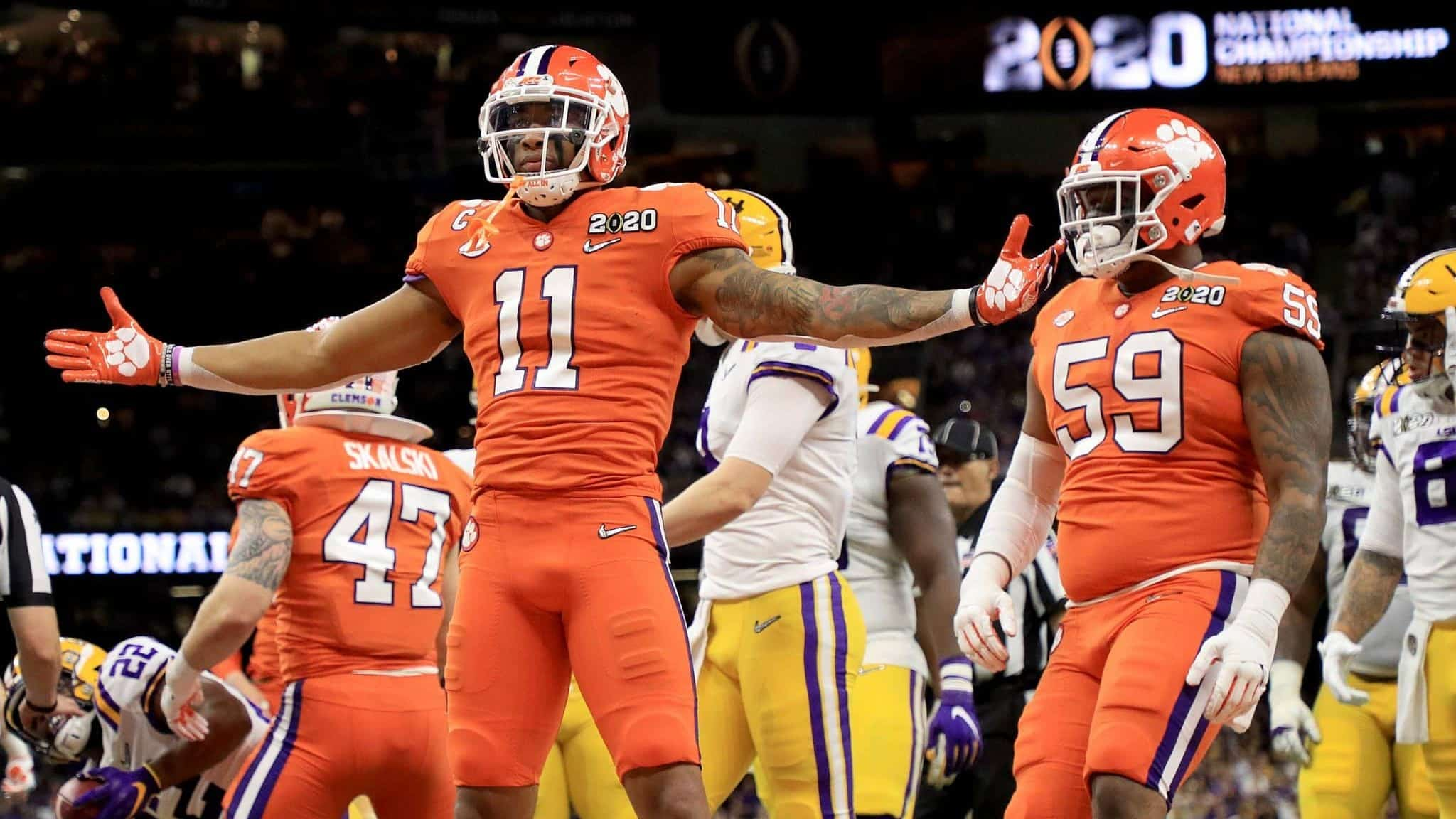 NEW ORLEANS, LOUISIANA - JANUARY 13: Isaiah Simmons #11 of the Clemson Tigers celebrates a defensive stop against the LSU Tigers during the first quarter in the College Football Playoff National Championship game at Mercedes Benz Superdome on January 13, 2020 in New Orleans, Louisiana.