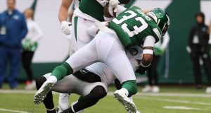 EAST RUTHERFORD, NEW JERSEY - NOVEMBER 24: Jamal Adams #33 of the New York Jets sacks Derek Carr #4 of the Oakland Raiders during their game at MetLife Stadium on November 24, 2019 in East Rutherford, New Jersey.