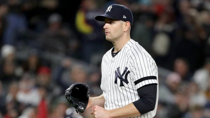 NEW YORK, NEW YORK - OCTOBER 18: James Paxton #65 of the New York Yankees walks back to the dugout after closing out the top of the top of the second inning against the Houston Astros in game five of the American League Championship Series at Yankee Stadium on October 18, 2019 in New York City.