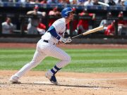 NEW YORK, NEW YORK - AUGUST 11: Jeff McNeil #6 of the New York Mets doubles and drives in two runs in the third inning against the Washington Nationals during their game at Citi Field on August 11, 2019 in New York City.