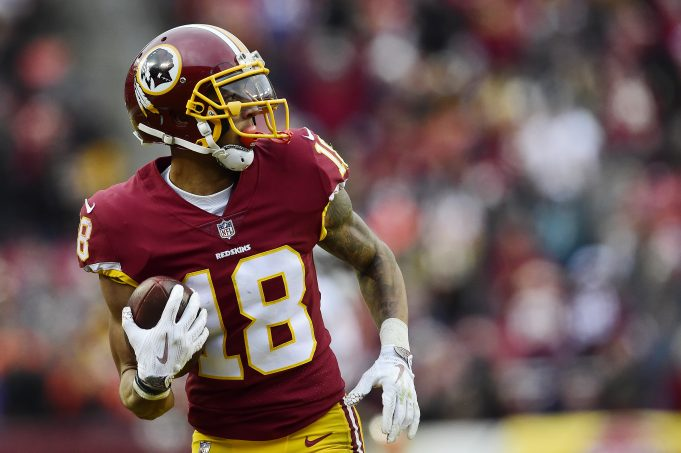 LANDOVER, MD - DECEMBER 24: Wide receiver Josh Doctson #18 of the Washington Redskins scores a touchdown against the Denver Broncos in the fourth quarter at FedExField on December 24, 2017 in Landover, Maryland.