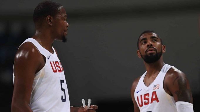 RIO DE JANEIRO, BRAZIL - AUGUST 08: Kevin Durant #5 and Kyrie Irving #10 of United States talk on the court during the Men's Priliminary Round between the United States and Venezuela on Day 3 of the Rio 2016 Olympic Games at Carioca Arena 1 on August 8, 2016 in Rio de Janeiro, Brazil.
