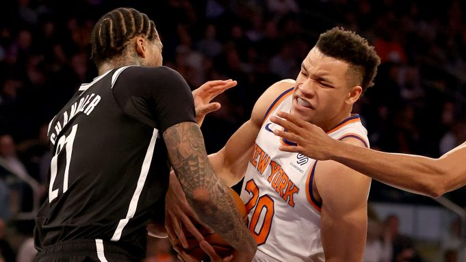 NEW YORK, NEW YORK - JANUARY 26: Wilson Chandler #21 of the Brooklyn Nets and Kevin Knox II #20 of the New York Knicks fight for the ball at Madison Square Garden on January 26, 2020 in New York City.NOTE TO USER: User expressly acknowledges and agrees that, by downloading and or using this photograph, User is consenting to the terms and conditions of the Getty Images License Agreement.